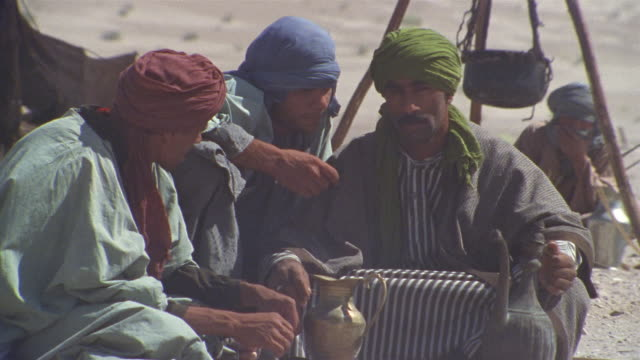 cu, middle east, three men in desert camp - see other clips from this shoot 1007 stock videos & royalty-free footage