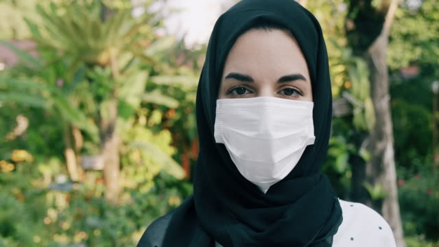 middle east woman wearing medical mask, to protect from virus. - middle eastern ethnicity stock videos & royalty-free footage
