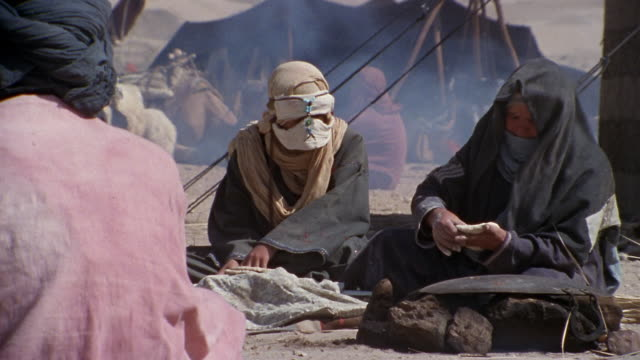cu, middle east, women baking flatbread in desert camp - see other clips from this shoot 1007 stock videos & royalty-free footage