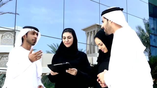 middle eastern business people on the street - slowmotion - united arab emirates stock videos & royalty-free footage