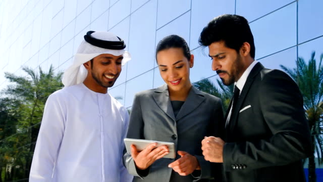 middle eastern businessmen and businesswoman working with digital tablet outdoor - middle eastern ethnicity stock videos & royalty-free footage