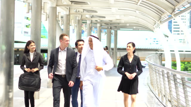 Middle eastern businessmen meeting in the capital city