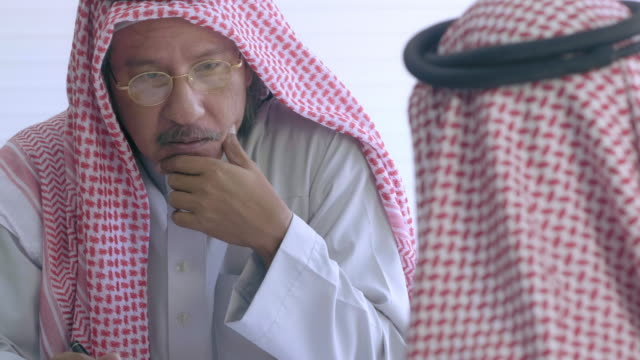 middle eastern businessmen meeting - saudi arabia stock videos & royalty-free footage