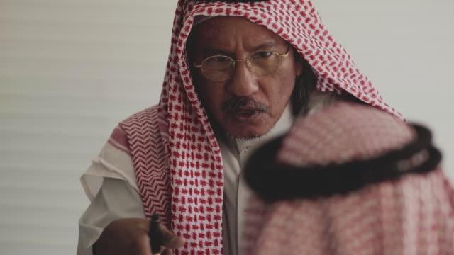 middle eastern businessmen meeting - bossy stock videos & royalty-free footage