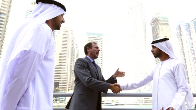 middle eastern businessmen meeting western man - stock video - colleague stock videos & royalty-free footage