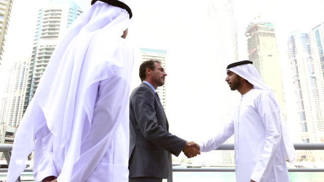 Middle eastern businessmen meeting western man - Stock video