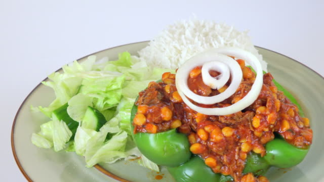 Middle Eastern Cuisine: Hash meat with a hot tomato sauce and sweet corn