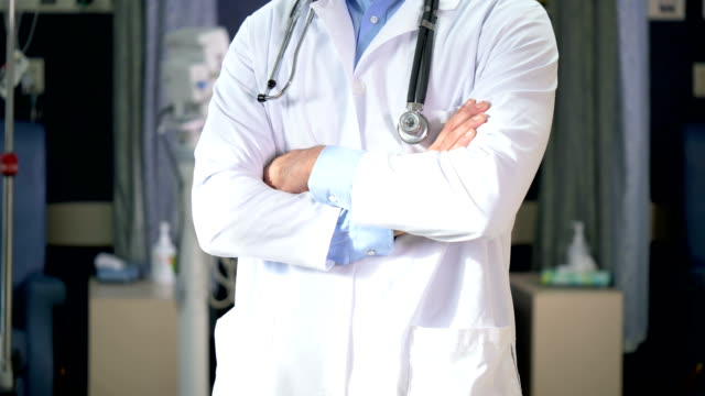middle eastern doctor in medical clinic - hands in pockets stock videos & royalty-free footage