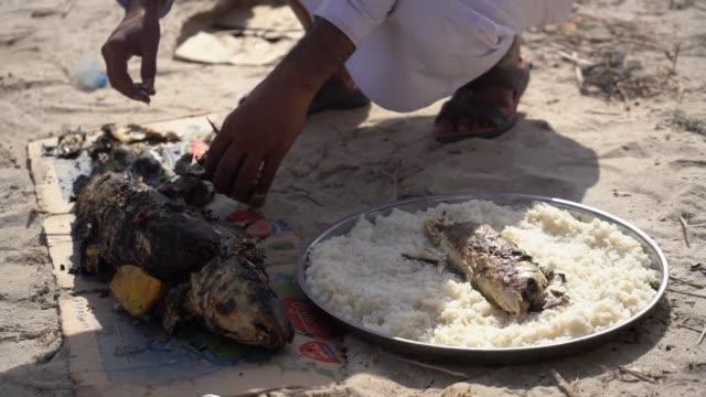MS Middle eastern man preparing food in the desert