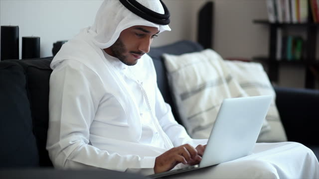 middle eastern man using laptop - working stock videos & royalty-free footage