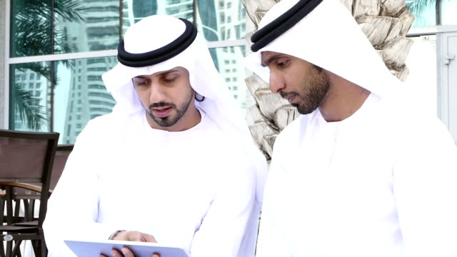 Middle eastern mans with digital tablet outdoor