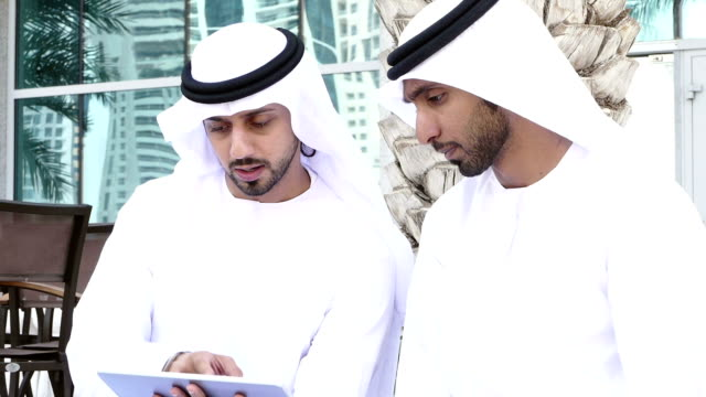 middle eastern mans with digital tablet outdoor - saudi arabia stock videos & royalty-free footage
