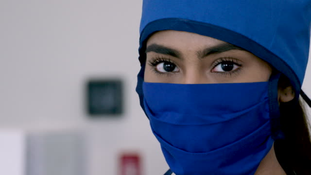 middle eastern medical professional wearing mask and cap - female nurse stock videos & royalty-free footage
