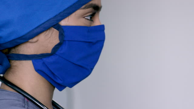 middle eastern medical professional wearing mask and cap - nurse cap stock videos & royalty-free footage