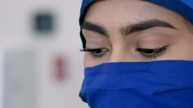 middle eastern medical professional wearing mask and cap - surgical mask stock videos & royalty-free footage