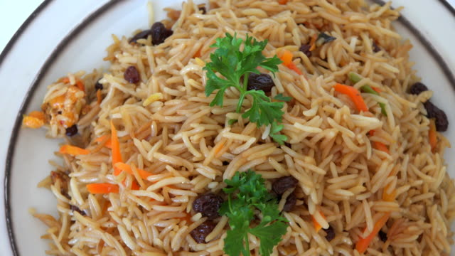 middle eastern raisin rice slowly turning on a food display - raisin stock videos & royalty-free footage