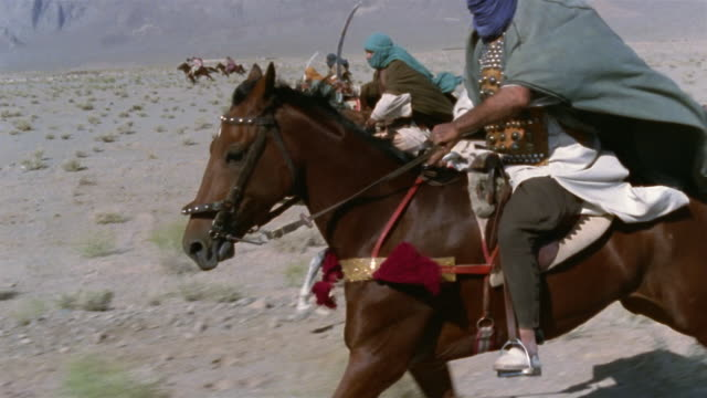 slo mo ws reenactment middle eastern warriors riding into battle on horseback and holding swords / iran - see other clips from this shoot 1007 stock videos & royalty-free footage