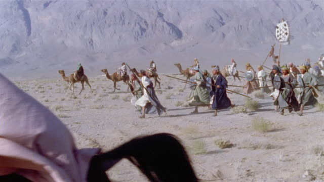 SLO MO WS REENACTMENT Middle Eastern warriors riding into battle on horseback and holding swords / Iran