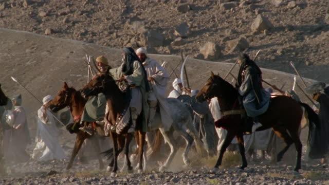 SLO MO WS REENACTMENT Middle Eastern warriors sword fighting on horseback during battle / Iran
