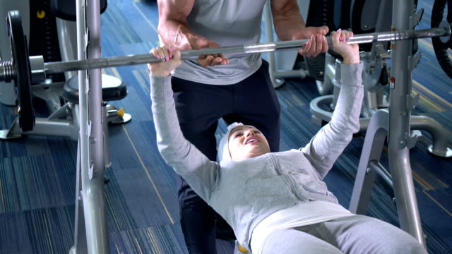 middle eastern woman with personal trainer at gym - weights stock videos & royalty-free footage