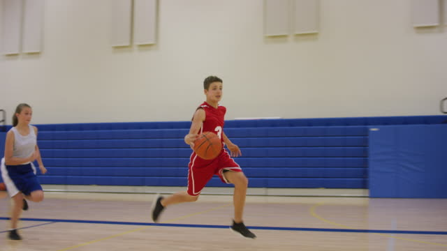 middle school boy makes a layup off a fast break - junior high stock videos & royalty-free footage