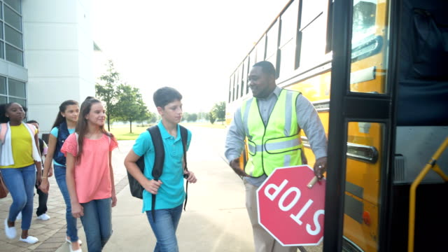middle school class boarding bus, boy with down syndrome - bus driver stock videos & royalty-free footage