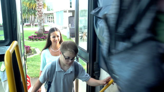 middle school class boarding bus, boy with down syndrome - 12 13 years stock videos & royalty-free footage