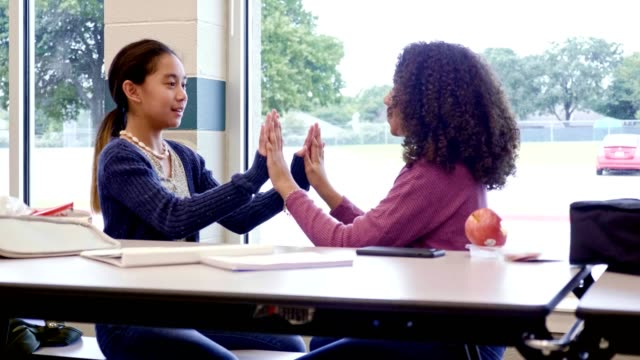 middle school girls play clapping game at school - school dinner stock videos & royalty-free footage