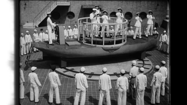 middle school students in uniforms train and observe nautical college students on the deck of a training ship in japan - sextant stock videos & royalty-free footage