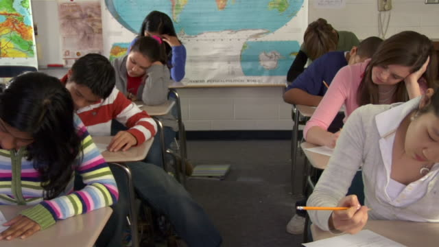 Middle School students quietly take a test.