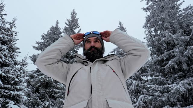 middle shot of one middle-aged man enjoying the winter mountain, portrait, winter sport, travel, exploration, adventure, tourism, mountain climbing, determination, athlete, ladder of success, extreme sports, outdoors - ladder of success stock videos & royalty-free footage