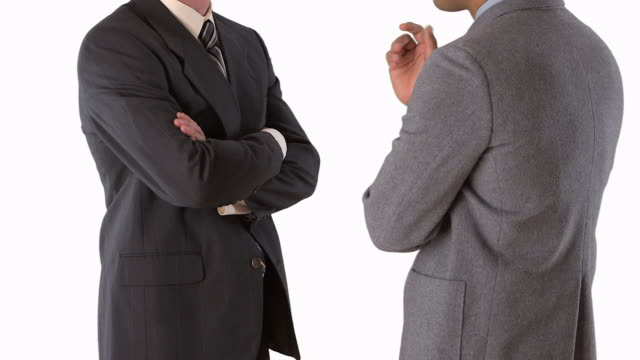 middle shot of two businessmen standing and talking - 全套西裝 個影片檔及 b 捲影像