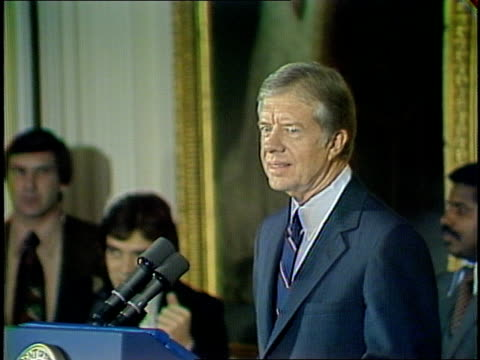 middle-aged and elderly african american and caucasian men and women assembled in the white house east room, standing and applauding upon arrival of... - jimmy carter us president stock videos & royalty-free footage