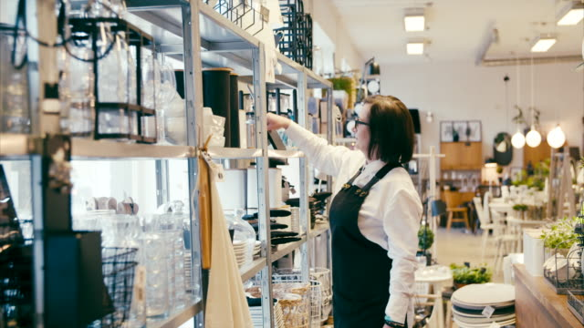 Middle-aged business owner working in a home decor shop