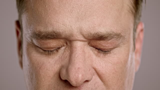 middle-aged caucasian man opening his eyes - open stock videos & royalty-free footage