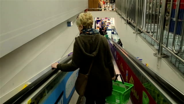 middle-aged woman buys at a supermarket