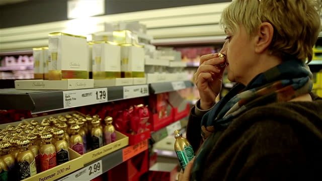 middle-aged woman chooses perfume for yourself