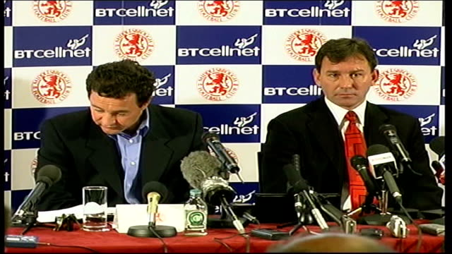 Bryan Robson to leave ITN ENGLAND Middlesbrough Bryan Robson along past with security guard and woman into Middlesbrough Football Club INT MS Steve...