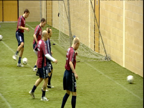 middlesbrough fc players kick balls against wall during indoor training session middlesbrough 08 jan 04 - middlesbrough stock videos and b-roll footage