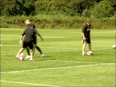 middlesbrough ext middlesbrough fc squad members on training pitch during training session watched over by gareth southgate - middlesbrough stock videos and b-roll footage