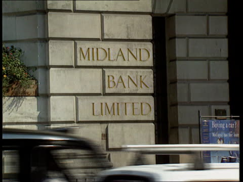 losses; england: [london ?] midland bank hq ? tilt down midland sign as traffic past in f/g int tgv l-r banking floor itn tx 2.8.90 - banking sign stock videos & royalty-free footage