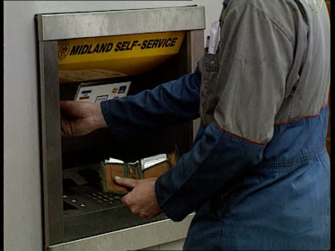 stockvideo's en b-roll-footage met midland bank takeover: lloyds backs down; england: ext gv midland bank branch; man using midland cash dispenser; gv lloyds bank hq ; zoom in midland... - plantdeel