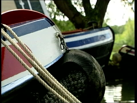 midlands: ext canal boats on canal bridge barge moored at side of canal i/c canal boats moored by side of canal cms tyre tied to side of canal boat... - barge stock videos & royalty-free footage