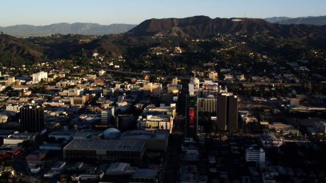 midlevel flight over hollywood, sign on hillside in distance. shot in october 2010. - artbeats stock videos & royalty-free footage