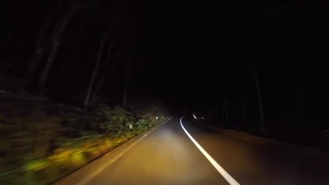 midnight mountain drive - headlight stock videos & royalty-free footage
