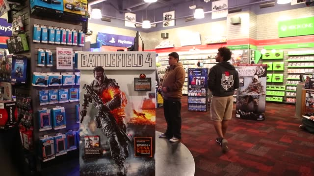 Midnight release of Electronic Arts Incs Battlefield 4 video game outside a GameStop Corp store in West Hollywood California US Customers browse...