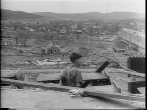 midnight tornado in berryville, arkansas kills 29 people on october 29, 1942 / montage of destruction including a demolished railroad station,... - only girls stock videos & royalty-free footage