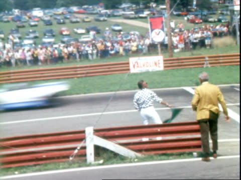 midohio start finish sign at midohio sports car course / traveling shots of peter revson driving mclaren m8f chevrolet denny hulme driving mclaren... - start flag stock videos & royalty-free footage