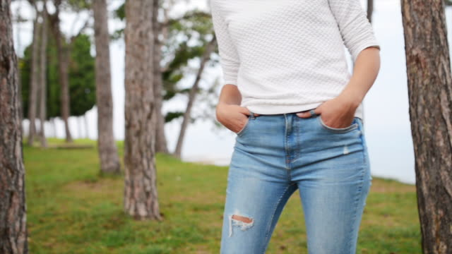 midsection of a young woman in casual clothing outdoors - jeans stock videos & royalty-free footage