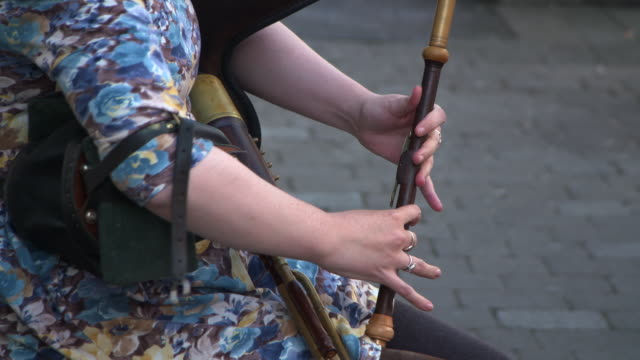 midsection of street musician playing musical instrument in city - galway, ireland - floral pattern stock videos & royalty-free footage